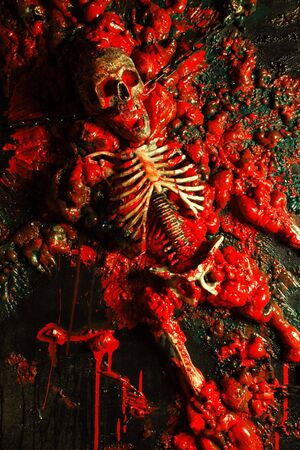 gruesome: Halloween image  background of blood, bones and guts.  Sculpture was built by me from a plastic skeleton, so I hold any copyrights.