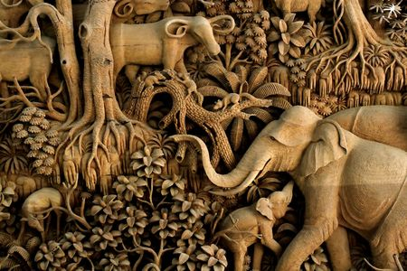 Section of an ancient mural wood carving from Thailand.