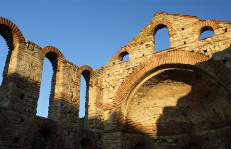 The ruins of an ancient basilica in Nessebar, Bulgaria - late in the day as the sun started to set. photo