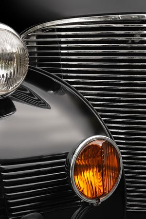 restoring: The chrome grill and headlights of an antique classic car. Stock Photo