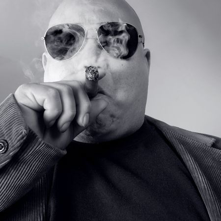 The big Boss, Head Honcho, An image of the Man in charge, smoking a cigar.