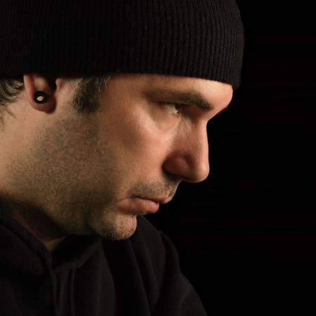 prowler: A suspicious male portrait - burglar, prowler, thief.