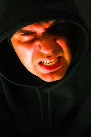 deranged: Angry hooded male looking at you with a slight bit of contempt.