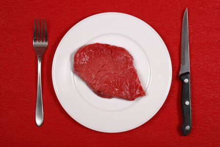 Raw meat on a dinner plate. photo