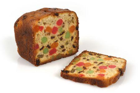 fruit cake: A freshly baked isolated loaf of candied Christmas fruitcake.