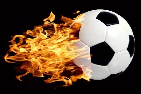 soccerball: An image of a leather soccer ball in flames soaring through the air.