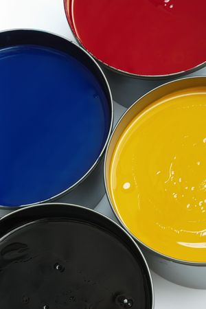 publishes: Tubs of process printing press inks, cyan, magenta, yellow and black.