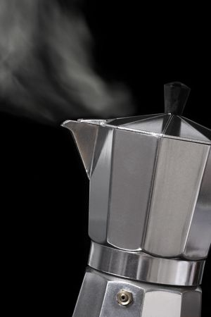 Image of an Italian Moka Express stovetop coffee maker blowing steam out its spout. photo