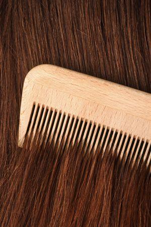 comb: A comb running through long brown hair. Stock Photo