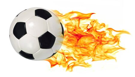 An image of a leather soccer ball in flames soaring through the air on a white background. Stock Photo