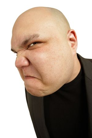 A bald man with an angry threatening sneer or disgusted look on his face.