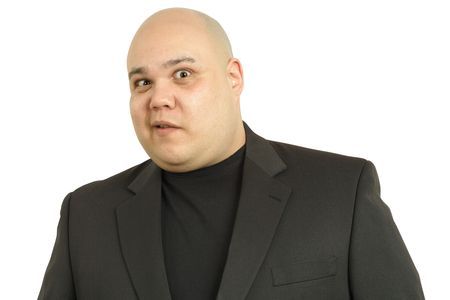 perplexed: A large bald man with a perplexed look on his face Stock Photo