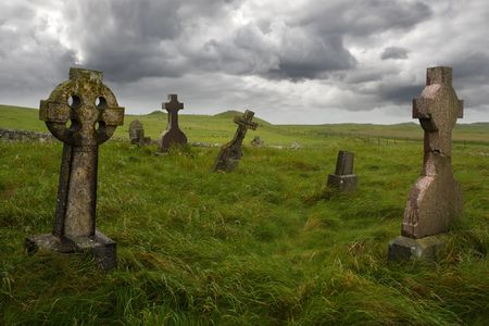 cemeteries: Ancient Celtic gravesite with unmarked gravestones from the 1600s in the middle of a meadow in rural Scotland.