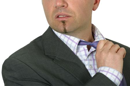 exasperated: Exasperated businessman in his thirties loosening his tie.  Focus is on the tie, face is slightly blurred.