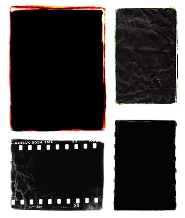 Series of four darkroom 35mm film photo borders with rough edges - one with sprocket holes, two with colour edges.  Frames were created by filing the metal edges of different negative carriers for my enlarger.