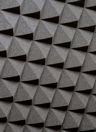 Background image of recording studio sound dampening acoustical foam.