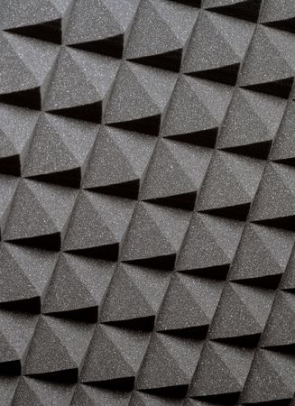 grey background texture: Background image of recording studio sound dampening acoustical foam.
