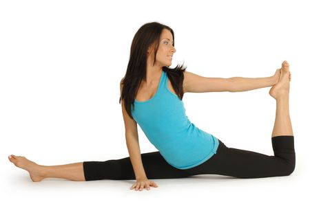 Young attractive women in her early 20s showing her flexibility doing the splits.
