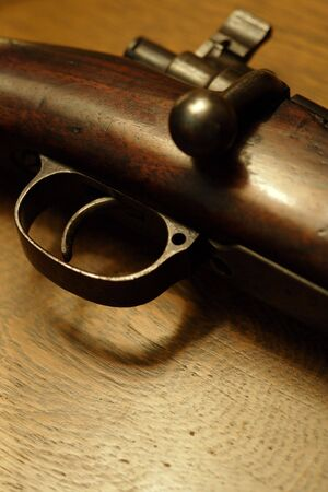 trigger: Very shallow depth of field image of the trigger of an old shotgun.  Focus is on the tip of the trigger.