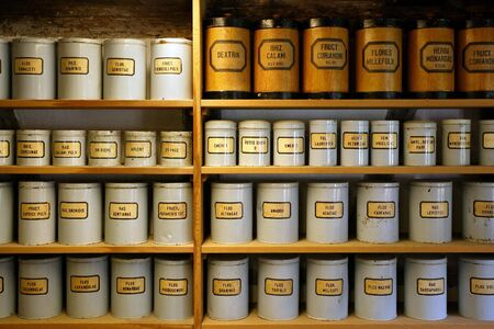 ambient: Background image of old pharmaceutical canisters used in creating medicine. Shot with ambient room lighting.  Stock Photo