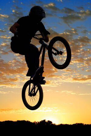 BMX bike high up in the air. photo