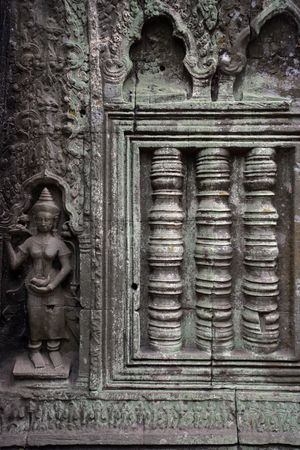 A carved wall of the Angkor temples in Siem Reap, Cambodia.  photo