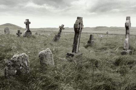 Ancient Celtic gravesite with unmarked gravestones from the 1600s in the middle of a meadow in rural Scotland.