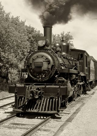 railway history: Image of an old locomotive done in sepia. Scanned film.