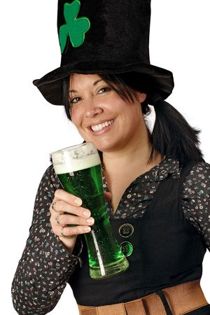 Pretty female with pigtails and hat drinking a tall glass of green beer on St. Patricks Day. photo