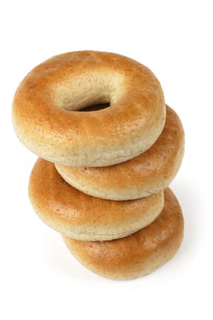 visible: A stack of four bagels isolated on a white background.  Slight shadow visible around right side. Stock Photo