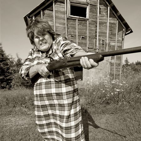 redneck: Shotgun Momma protects her moonshining barn with a rather large shotgun.
