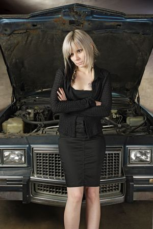 A frustrated blond female in her 30's waiting for a mechanic to fix her car. Stock Photo - 4916026