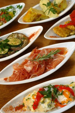spanish food: A table full of Spanish tapas.