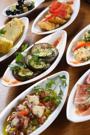A table full of traditional Spanish tapas.