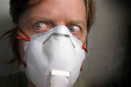 paranoid: A man in his early 40s paranoid about flu viruses wearing a protective mask.