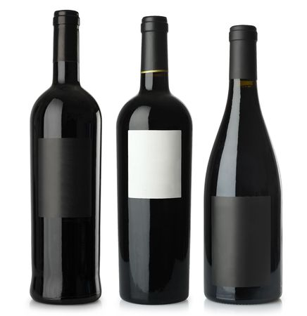 Three merged photographs of different shape red wine bottles with blank labels.  Separate clipping paths for bottles and labels included. Stock Photo