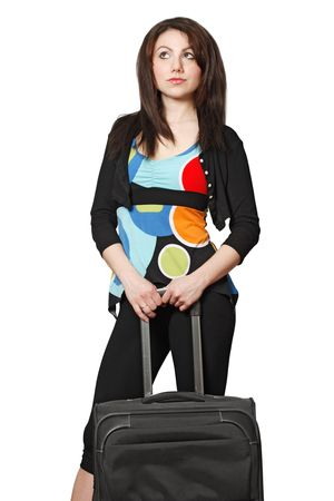 A beautiful brunette waiting to travel with a black suitcase.  Isolated on a white background. Stock Photo - 5435330