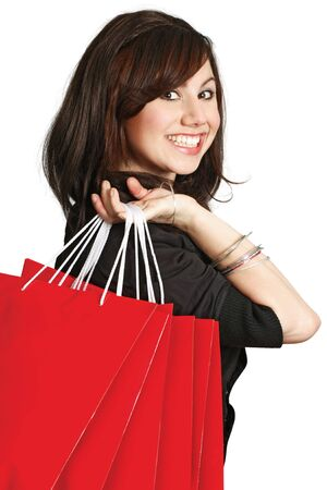 consumerism: A very happy shopping girl holding bags and smiling wildly about her rabid consumerism.