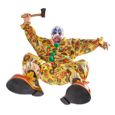 hatchet man: A nasty evil clown, angry, jumping, and about to hack you to bits.  Motion blur on the knees and shoes. Stock Photo