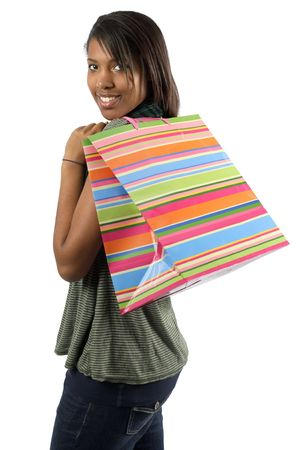 consumerism: A very happy shopaholic girl holding a bag and smiling wildly about her rabid consumerism. Stock Photo