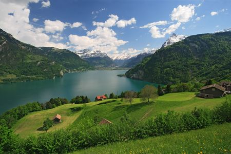 Looking over fields, farms and Lake Lucerne in Switzerland. Stock Photo