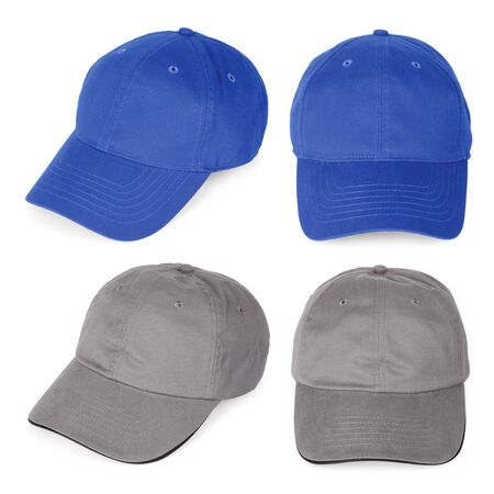 on gray: Isolated blank baseball caps ready for your logo or design.