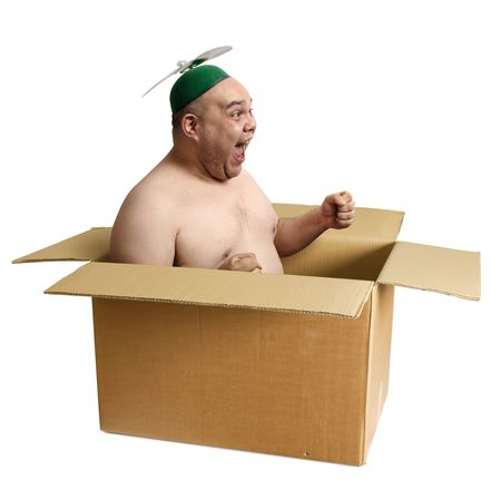 30s: An adult male in his 30s playing airplane in an old cardboard box.