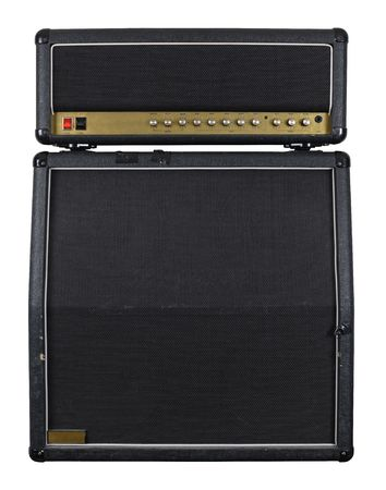 Photograph of the front of a combo guitar amplifier with speaker cabinet.  photo