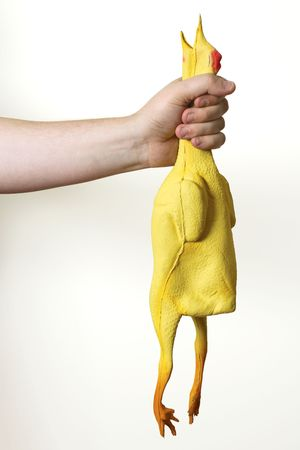 Image of a rubber chicken being choked.  Metaphor for male self-gratification.