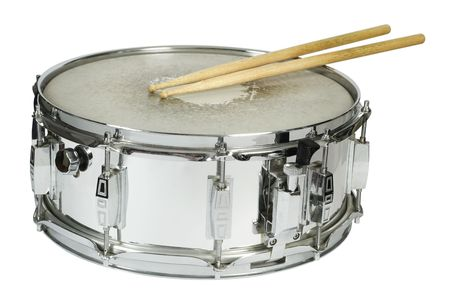 drums: Drumsticks resting on a well-worn metal snare drum. Stock Photo