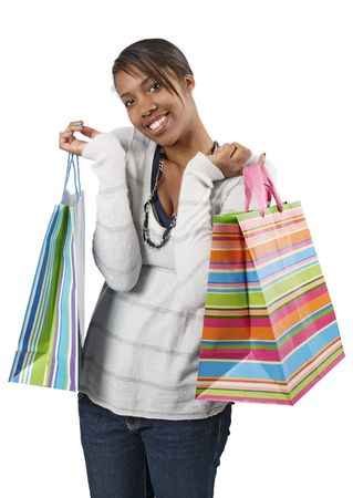 consumerism: A very happy shopaholic girl holding bags and smiling wildly about her rabid consumerism.