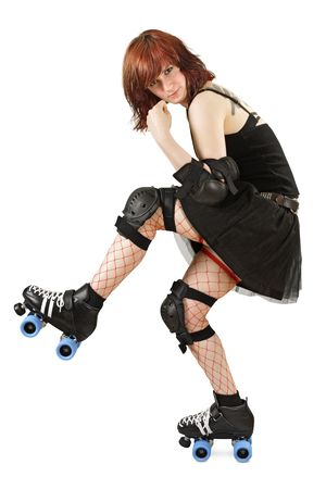 Photograph of a roller derby girl posing with her equipment. Slight shadow under skate.