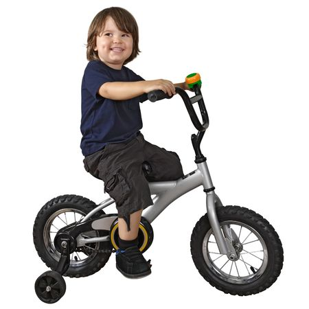 training wheels: An adorable 3-year-old riding his bicycle fitted with training wheels.
