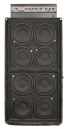 amp: Photograph of the front of an old guitar or bass amplifier.  Stock Photo